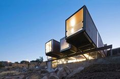 large shipping container home on stilts
