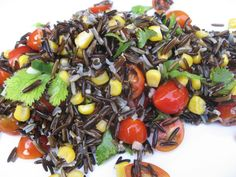 Sprouted Wild Rice with Corn and Tomato  Makes 2 servings    1 1/2 cup soaked wild rice (started with 1 cup + 2 cups soak water)  1 cup cherry tomatoes, halved  1/2 cup corn kernels  1/2 teaspoon garlic, minced  1/2 teaspoon jalapeno pepper, deseed, dice, to taste  3 tablespoons cilantro, chopped  1 tablespoon olive oil, optional  1/4 teaspoon sea salt, optional