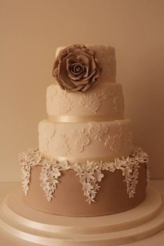 'this is clever how the flowers drip down the bottom tier''Vintage style wedding cake