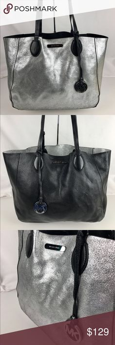 """Michael Kors Mae Large East West Reversible Tote Authentic. Gently Used with Dust Bag and Care Card. Reversible. Some wear on handle edges.  Soft, bicolor bonded leather. For added versatility, this stylish bag is reversible. Includes Acc bag. Handles with 9-1/2"""" drop. Open Top. Interior features detachable zip pouch. 17-1/2"""" W x 12"""" H x 6"""" D. Style 30S6SM5T3M. Our bag # RB761.   Thank you for your interest!  PLEASE - NO TRADES / NO LOW BALL OFFERS / NO OFFERS IN COMMENTS - USE THE OFFER…"""