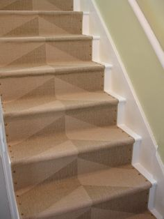 A stair runner using Ikea rugs and nailheads. From loft & cottage: diy nailhead stair runner