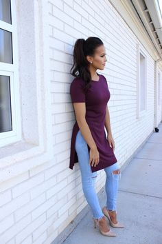 Oxblood split side short sleeve tee with light blue denim cut off jeans. High Ponytail swag. Maroon + Nude
