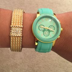 """Stylish Mint/Gold Watch- Watch Only Accessorize your wrist with the perfect addition of style and class. T&J Designs Mint Watch with gold accents adds glamour to any outfit you are wearing! The stunning faux leather bracelet when worn with the watch gives it a sparkle that cannot be ignored! Find the bundled watch/bracelet in my closet   Face 1.5"""" diameter, watchband .75"""" wide  Approx 7"""" length with 1"""" extension  Watch Material: rubber, gold plated base metals, hoop and buckle  Lead free…"""
