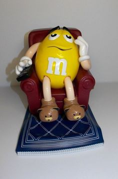 "1999 MARS INC. Yellow ""M"" Peanut & The M&M's In Chair Candy Dispenser Figurine"