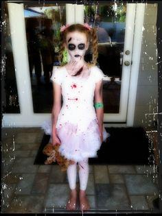 Little girl zombie Halloween makeup, hair & costume.