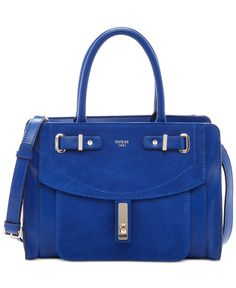 """Go from office to after-hours effortlessly with Guess's stylish structured satchel, fashioned in faux leather with shiny golden hardware and a removable strap. 