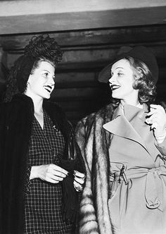 It just doesn't get much better. Rita Hayworth and Marlene Dietrich depart for Hollywood after a New York visit, 1941