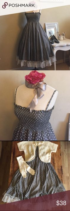Flirty Polka Dot Dress Full circle skirt with white tule ruffle. Entirely smocked bodice. Skirt has strings sewn on the inside of it to create gathered effect on each gore. 100% cotton. Simply beautiful. Featured shoes are also for sale. Double Zero Dresses