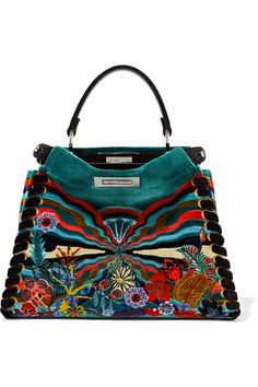 Fendi's 'Peekaboo' tote was spotlighted in The EDIT's 'The Clash' - a feature on how to master colorful mixing of patterns. Carried on the Fall '16 runway, this iconic bag is updated in opulent jewel-tone velvet and printed with rainbow-hued flora and fauna motifs. It's finished with chunky whipstitched trims, a detachable leather shoulder strap and protective feet.