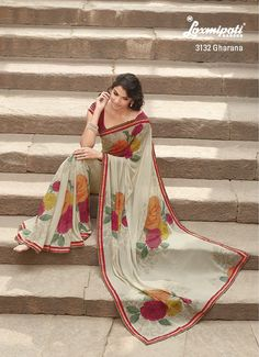 Multi floral print on the tan marvel chiffon  saree is catching attention with printed lace.