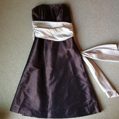 Designer prom/formal /wedding guest dress Beautiful dark chocolate brown & gold/tan bridesmaid dress. Strapless with semi-low back. Zips in back. Gold/tan empire tie is long in back. Modest length. Great for wedding guest / formal gala or party / prom. Great condition- worn once. Fully lined. 100% polyester shell, 100% acetate lining. Wire ribbing at bust for nice fit & shape & to help hold dress up. (This is very much like the J. Crew bridal party dresses). I also have the reverse color…