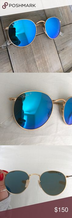 Authentic Polarized RayBan 3447 RoundFlash Glasses Super retro and trendy RayBan polarized blue flash round lens sunglasses! They have a matte gold frame and have only been worn once! There is one very small scratch that is hardly noticeable but besides that they are in like new condition! Check out the pictures and also the description in the picture taken from the RayBan website for more details! These beautiful sunglasses unfortunately do not come with a case but they will be shipped…