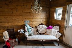 rustic and vintage items placed in a corner for fun party pic opportunities - thereddirtbride.com  - see more of this wedding here