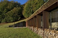 While not exactly a home, this earth-sheltered barn extension is still a great practical example of an earth berm structure with green roof // Building Extension, Roofing Options, Agricultural Buildings, Underground Homes, Stone Barns, Natural Building, Green Building, Earth Homes, Dordogne