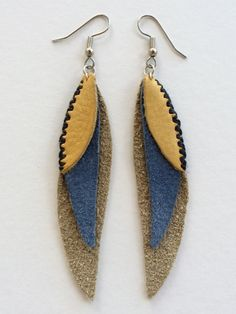 Parrot feather leather and sinew earring by twigsandbones