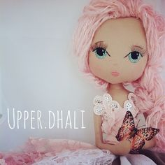 Each Upper Dhali handcrafted doll is an exquisite keepsake designed & crafted especially for you by Lou Peters.