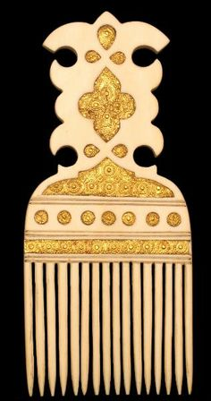 Ivory & Gold Hair Comb, probably Zanzibar, c. 1800 - Middle East 18th-19th c. - ivory - length: 12.5 cm; width: 5.5 cm  A fine and extremely rare ivory comb that is a beautiful example of what is most likely Islamic East African craftsmanship. Cut from a single piece of ivory, it has sixteen prongs and is inlaid on both sides with chased gold plaques. There are no losses either to the gold or the ivory. The combination of ivory and inlaid gold disks and bands is typical of Zanzibari work.