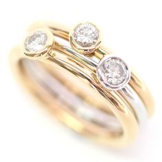 A pretty and versatile set of 18ct White and Yellow Gold Diamond Stacking Rings handmade by Form Bespoke Jewellers using the customer's diamonds.
