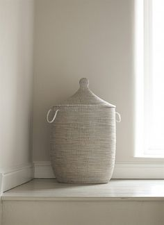 A stunning handmade coiled laundry basket with matching lid