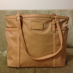 New Authentic Kate Spade Union Square Bag New without tags. Authentic Kate Spade Union Square Clementine Shoulder Bag. Lightweight nylon. Length 11.3 inches. Height 10.5 inches. Depth 6.5 inches. No dust bag. There is a minor DEFECT. Please see last picture. Retail $328 plus tax. NOT TRADING. PRICE FIRM. $115 on mercar including shipping. kate spade Bags Totes