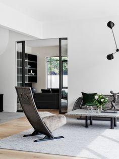 Living room in a Toorak home by Robson Rak. Photo by Brooke Holm.