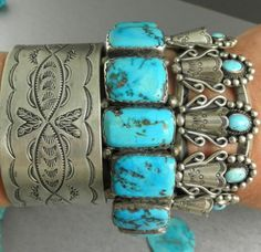 Old pawn silver and turquoise bracelets. Squash blossom turquoise cuff