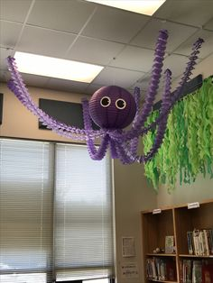 24 inch langer, paper garland and made the eyes with my cricut. Could not have been easier. it is decorating in my elementary school library. Under The Sea Theme, Under The Sea Party, Under The Sea Decorations, Ocean Party Decorations, Paper Decorations, Classroom Themes, Ocean Themed Classroom, Paper Lanterns, Paper Garlands