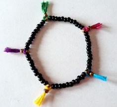 DIY Beaded Tassel Bracelet By Erin from Thanks, I Made It via AllFreeJewelryMaking.com