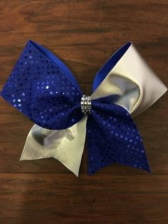 Custom Tic-Tock Cheer Bows by CharacterBowtiqueTH on Etsy