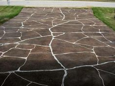 want to do this to my concrete driveway - staining and etching to look like stone
