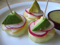 Rad Bites.  Simple too.  Just top a cucumber slice with a little pear, some radish and avocado.  Delish.