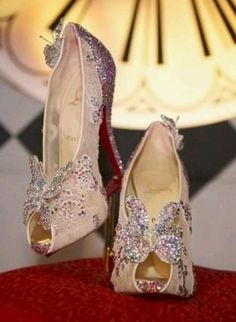 I love butterflies...and I would attend a black tie event to just find the perfect dress for these over the top shoes!