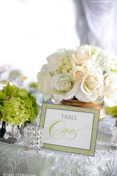 Elegant Gold, Green, and Ivory Wedding table