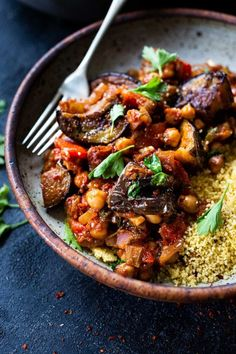 A simple delicious Tagine Recipe with Eggplant and Chickpeas infused with Moroccan spices, served over cinnamon-scented couscous. This flavorful Eggplant Chickpea Stew is vegan and gluten-free. Healthy Dinner Recipes, Real Food Recipes, Vegan Recipes, Vegan Eggplant Recipes, Vegetarian Meals, Curry Recipes, Free Recipes, Polenta, Vegetable Dishes