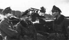 Oblt. Wilhelm Batz (on the right) in conversation with Hptm. Gerd Barkhorn (301 victories) and Lt. Heinrich Sturm (157 victories) in front of untagged Bf.