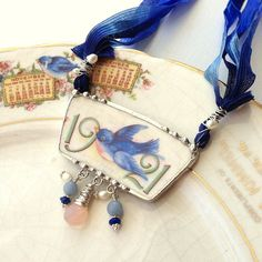 Antique 1921 bluebird china calendar plate broken china jewelry necklace made from a broken plate