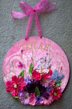 """Another gorgeous fairy garden hanger. I simply love this one! Lots of flowers and sparkles just """"make"""" this! Taylah's name looks gold here, but is silver (it's the reflection making it look gold). Pic 1 of 2"""