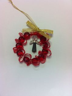 Red Xmas wreath with angel and red glass beads