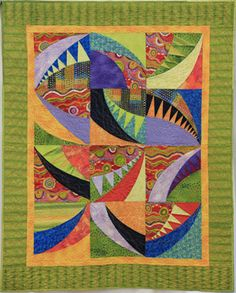 """3rd Tie ~ Glarmoft (6022) ~ Lynda Wolf ~ 49""""x61""""This was my first paper-pieced quilt and I had fun with all the colorful fabrics. Machine pieced. Machine-quilted. Source – Pattern by Pamela Goecke of Dinndorf and Aardvark Quilts."""
