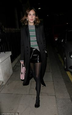 Fashionista: The designer wore a grey and green striped knit with a black PVC miniskirt and black tights