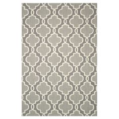 Hand-hooked rug with a quatrefoil motif in grey.     Product: RugConstruction Material: 100% PolyesterColo...
