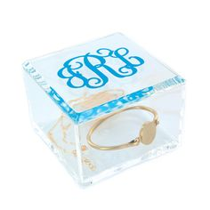 """Looking for the perfect place to storeyour trinkets or place your favorite  jewelry pieces? These elegant personalized acrylic square boxes with  lidsmake the perfect gift for yourself or a special friend who appreciates  staying organized in style. Vinyl decal is available in 26 vibrant colors.  Boxdimensions: 3.75"""" x 3.75"""" x 2.75""""  Note: Selection of Vinyl Font and Personalization can be done once the item  is added to your shopping cart."""
