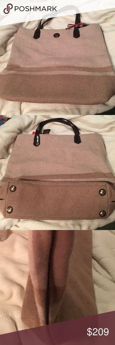 """NWOT Coach Signature stripe wool north/south tote Brass/Camel/Mahogany/ in color with red patent bow. Has patent brown trim. Inside zip, cellphone and multifunctional pockets. Claw clip closure. Camel colored fabric lining. Handles 5 1/2"""" drop. Length 15"""". Height 13 3/4"""". Width 4 1/4"""". Coach Bags Totes"""