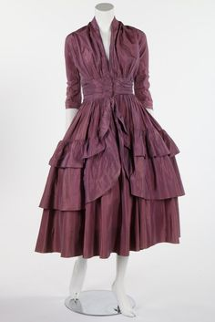 An unusual Jean Patou couture rayon taffeta robe-de-style style cocktail dress, probably circa 1940. with pink and white woven label, with centre-front hook and eye fastenings, tiered flounces to the skirt