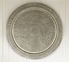 Love! Not sure if I like this or the woven hanging better. Decorative Metal Disc - Silver #potterybarn