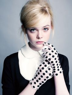 Elle Fanning in a lady-like outfit in Elle:Top, 550$, collar, 490$, Louis Vuitton; gloves, 40$, Carolina Amato.
