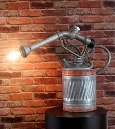 SOLD..........One of my favorite industrial modern pieces that is a conversation piece to say the least! A vintage gas can and vintage gas pump married together makes for a perfect industrial modern table lamp.