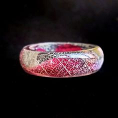 Unique handmade Ring with Frosty pattern and Red natural petals made from eco resin, silver skeleton leaf, red petals of natural flowers. I love to walk on the sea costs and flowering meadows, I like to feel its awesome aromat, feel breeze and drops of water on my skin, to watch countless shades of blue on the sea and the sky. My works are about it. In them I am keeping beauty of nature for rainy day ).  ✿ Number 6 US / 16.5 mm diameter  ✿ Number 7 US / 17.3 mm diameter  ✿ Number 8 US…