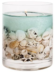 Ocean gel candle. Shop & DIY. Gel candle ideas with shells. Featured on Completely Coastal