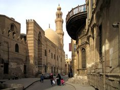 Madrasa of Sultan al-Nasir Muhammad stands the Madrasa Khanqah of Sultan al-Zahir Barquq at Nahhasin on the street called al-Mu'izz in Islamic Cairo, which can be dated to between 1384 and 1386 AD. The architect Shihab al Din Ahmad ibn Muhammad al Tuluni, who belonged to a family of court architects and surveyors, was in charge of part of the construction. Cairo, Egypt  (picture courtesy: David Stanley)